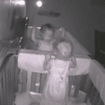 twin girls caught on baby cam
