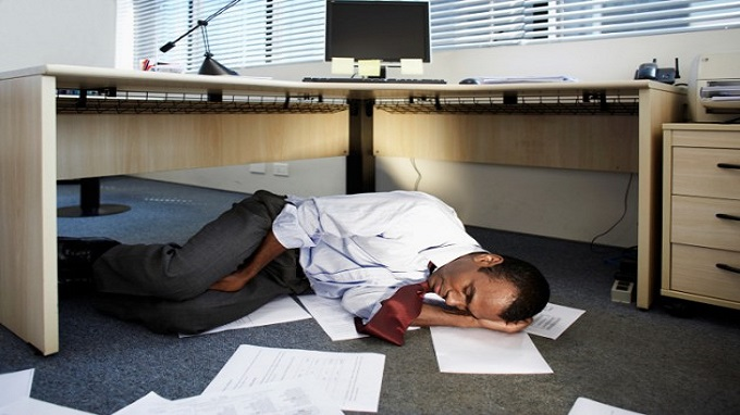 Man-sleeping-under-desk-credit-whitetag-467189761-630x419